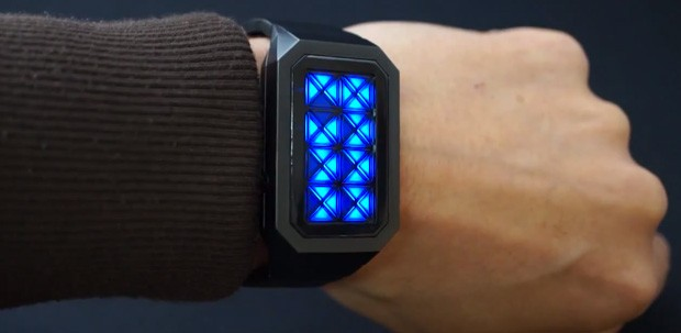 Tokyoflash Kisai Adjust watch tells time with triangles, in trippy colors video